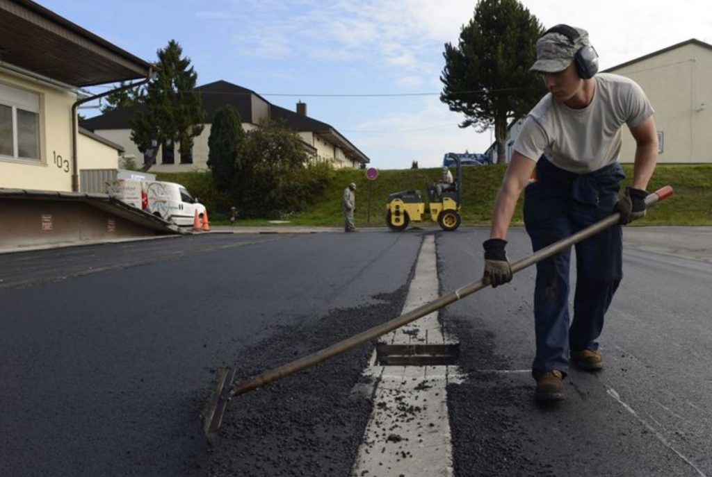spreading asphalt